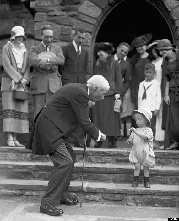 UNITED STATES - JULY 08: John D. Rockefeller marks his 84th birthday by handing out a nickel to Robert Irving Hunter, 2, who politely gives it back at first, after services at New Community Church in Westchester County. (Photo by NY Daily News Archive via Getty Images)